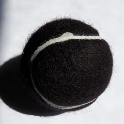 black tennis ball.jpg
